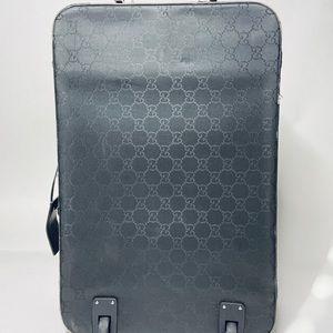 Sleek Gucci Monogram Roller Suitcase